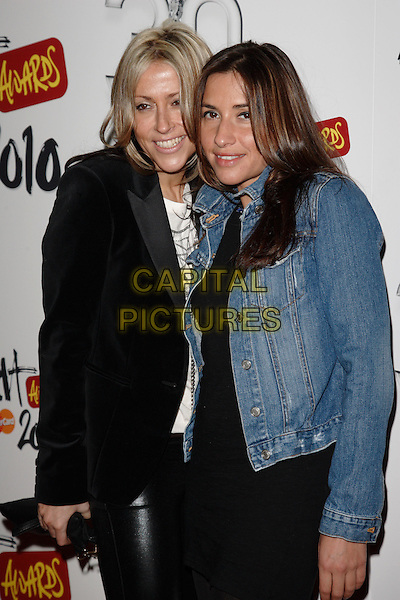 NICOLE APPLETON & MELANIE BLATT.Brit Awards Nominations at Indigo O2, London, England, UK,.January 18th 2010..brits half length Mel black denim jacket velvet blazer dress leather rubber leggings .CAP/ROS.©Steve Ross/Capital Pictures