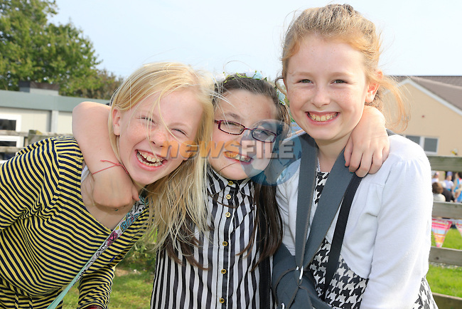 Caoimhe Randle Sophie Kelly and Hazel Townley at the St. Colmcille's School,Tullydonnell, celebrates its Harvest Festival.<br /> Picture: www.newsfile.ie
