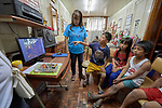 Deaconess Christy Flores leads a group of children in a discussion about a video in the Knox United Methodist Church in Manila, Philippines. She is a graduate of Harris Memorial College.