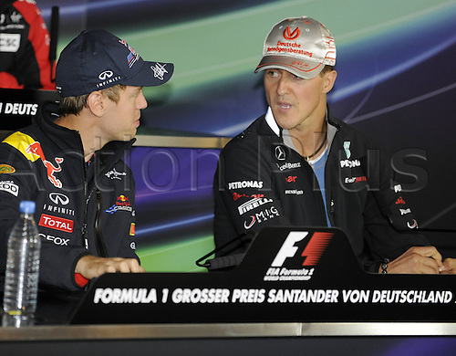 21 07 2011  Sebastian Vettel ger Red Bull discusses a point with Michael Schumacher ger Mercedes at the press conference for the Formula 1 Nuerburgring GP Germany
