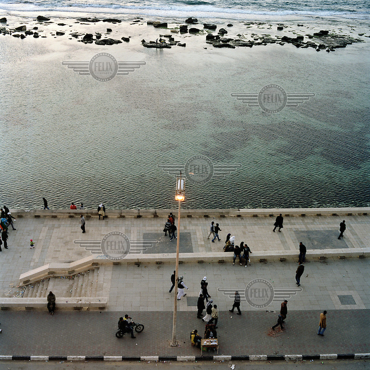 People walk along the corniche in Benghazi.