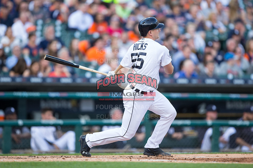 John Hicks (55) of the Detroit Tigers follows through on his swing against the Chicago White Sox at Comerica Park on June 2, 2017 in Detroit, Michigan.  The Tigers defeated the White Sox 15-5.  (Brian Westerholt/Four Seam Images)