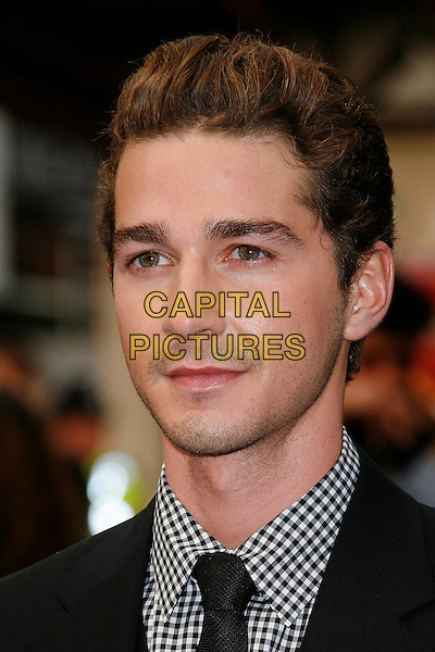 SHIA LaBEOUF.'Transformers: Revenge of the Fallen' .UK film premiere at Odeon cinema, Leicester Square, London, England..15th June 2009.headshot portrait black white gingham stubble facial hair LaBoeuf La Boeuf.CAP/DAR.©Darwin/Capital Pictures.
