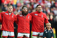 Harry Jones, Hubert Buydens and Jamie Cudmore of Canada sing their national anthem prior to the match. Rugby World Cup Pool D match between Canada and Romania on October 6, 2015 at Leicester City Stadium in Leicester, England. Photo by: Patrick Khachfe / Onside Images