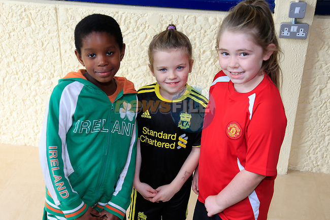 Colette ogunmola<br /> Leah Newman<br /> Abi Kerr GOAL Jersey Day in Marymount National School.<br /> Picture Fran Caffrey www.golffile.ie