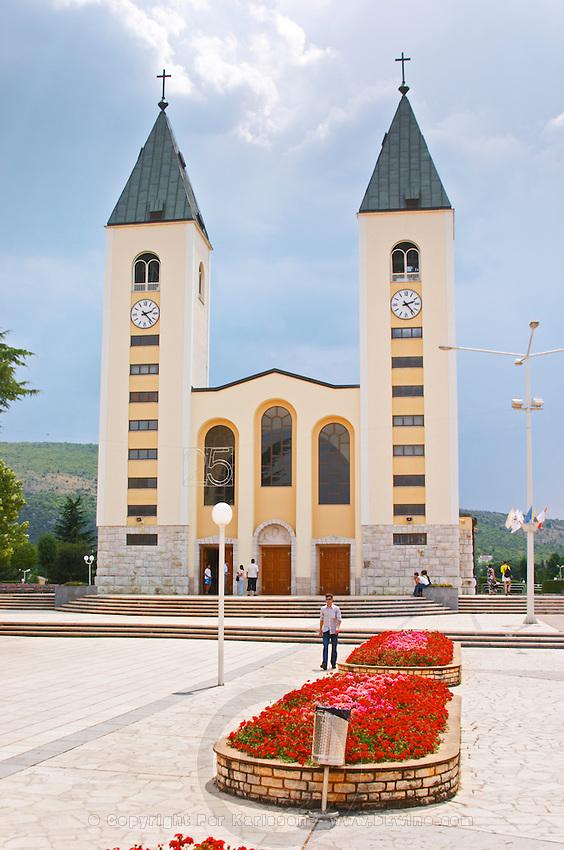 The church with its twin church towers. Medugorje pilgrimage village, near Mostar. Medjugorje. Federation Bosne i Hercegovine. Bosnia Herzegovina, Europe.