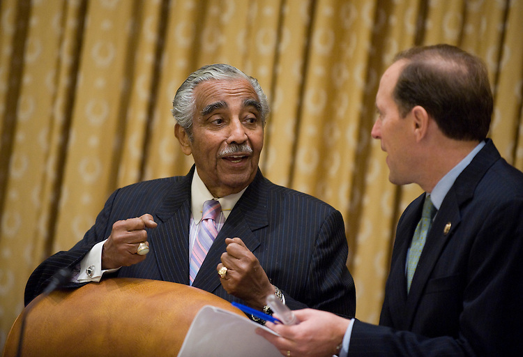 Chairman Charlie Rangel, D-N.Y., left, confers with ranking member Rep. Dave Camp, R-Mich., before a House Ways and Means Committee markup on the approval of the reconciliation letter to the House Budget Committee, Oct. 15, 2009.