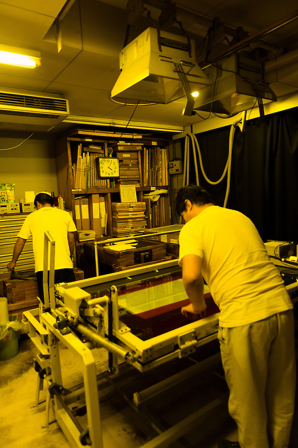 Preparing to expose the gelatine-coated glass printing plates. Benrido collotype atelier, Kyoto, Japan, October 9, 2015. The Benrido collotype atelier in Kyoto was founded in 1887 and is the only full-scale commercial collotype atelier in the world. Collotype is a historic photographic printing process that makes use of plates coated in gelatine. It produces prints of unrivalled quality.