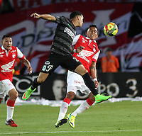 BOGOTA -COLOMBIA, 5- OCTUBRE-2014. Francisco Meza ( Der) de Independiente  Santa Fe  disputa el balón con Alejandro Guerra  ( Izq) del Atletico Nacional durante partido   de La Liga Postobón treceava fecha 2014-2. Estadio  Nemesio Camacho El Campin    / Francisco Meza  (R) of Independiente Santa Fe fights for the ball with Alejandro Guerra (L) of Atletico Nacional during La Liga match Postobón  13th 2014-2.  Nemesio Camacho El Campin stadium . Photo: VizzorImage / Felipe Caicedo / Staff