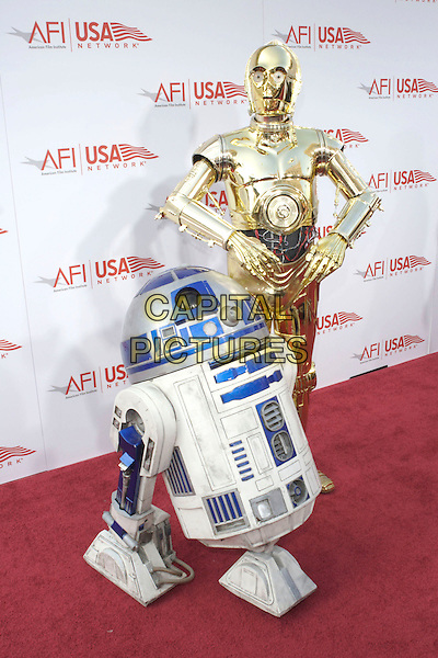 R2D2 & C3PO.33rd AFI Life Achievement Award Featuring George Lucas held at the Kodak Theatre, Hollywood, California, USA,.9th June 2005..full length starwars characters costumes robots.Ref: ADM.www.capitalpictures.com.sales@capitalpictures.com.©Zach Lipp/AdMedia/Capital Pictures .