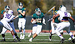 SPEARFISH, S.D. -- OCTOBER 1, 2016: Phydell Paris #34 of Black Hills State runs between blockers and toward New Mexico Highlands defenders Xzavion Patterson #90 and Erick Zarate #8 during their game Saturday at Lyle Hare Stadium in Spearfish, S.D.  (Photo by Dick Carlson/Inertia)
