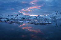 Winter sunset over mountain of Moskenesøy from Fredvang bridges, Lofoten Islands, Norway