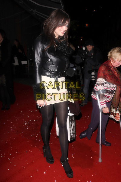 DAISY LOWE.Cecile & Hermione English National Ballet's Christmas VIP Party at St Martins Hotel, London, England..December 16th 2009 .full length black sheepskin lined fur collar leather biker jacket tights shoes platform mini dress white cream bag.CAP/AH.©Adam Houghton/Capital Pictures.