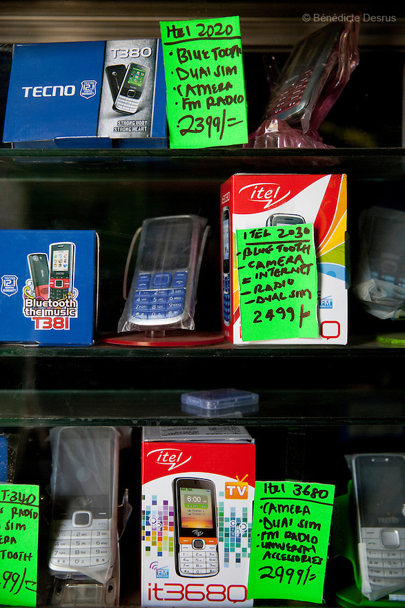 A vendor sells mobile phones at his shop in Nairobi slum on March 22, 2013. (Photo by Benedicte Desrus)