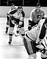 Seals vs. Flyers: Seals #9 Wayne Carleton with Flyers Barry Ashbee.  (1971 photo/Ron Riesterer)