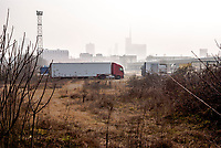 Milano, periferia nord. Ex scalo merci ferroviario Farini. Camion --- Milan, north periphery. Freight railway yard Farini. Trucks