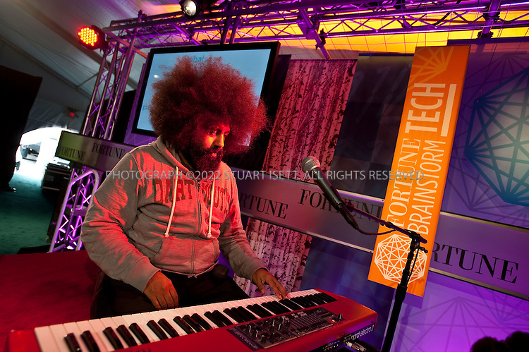 July 19th, 2011--Aspen, CO, USA..Reggie Watts sets up at the Fortune Brainstorm TECH at the Aspen Institute Campus...Reggie Watts (born March 23, 1972) is a Seattle-based comedian and musician. His shows are mostly improvised and consist of stream of consciousness stand-up in various shifting personae, mixed with loop pedal-based a cappella compositions. He also performs regularly on television, radio, and in live theater. His comic skills come into play in improvisational performance, as well as performance of written music...©2011 Stuart Isett. All rights reserved.