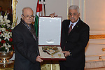 Palestinian President Mahmoud Abbas honors Farouk Kaddoumi,  the Member of the Executive Committee of the Palestine Liberation Organization, in Tunis, January 22, 2015. Photo by Thaer Ganaim