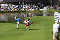 Rory McIlroy (NIR) and caddy J.P.Fitzgerald walk to the 18th green during Friday's Round 2 of the 2014 Irish Open held at Fota Island Resort, Cork, Ireland. 20th June 2014.<br /> Picture: Eoin Clarke www.golffile.ie