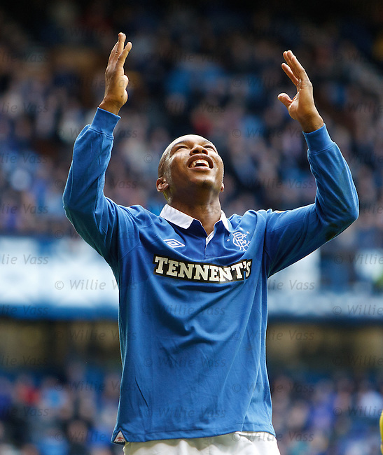 El Hadji Diouf looks to the heavens as his diamond tooth glistens