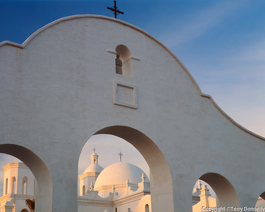 San Xavier Reservation, AZ  <br /> Dawn light on north arches and towers of the San Xavier del Bac Mission