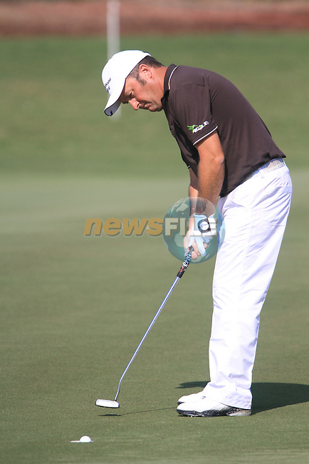 Damien McGrane takes his putt on the 15th green during Day 3 of the Dubai World Championship, Earth Course, Jumeirah Golf Estates, Dubai, 27th November 2010..(Picture Eoin Clarke/www.golffile.ie)