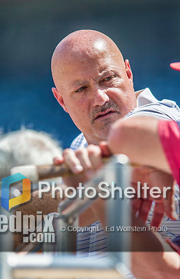 6 September 2014: Washington Nationals General Manager Mike Rizzo watches batting practice prior to a game against the Philadelphia Phillies at Nationals Park in Washington, DC. The Nationals fell to the Phillies 3-1 in the second game of their 3-game series. Mandatory Credit: Ed Wolfstein Photo *** RAW (NEF) Image File Available ***