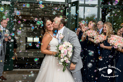 bride and groom with bubbles by Tallmadge wedding photographer Mara Robinson Photography