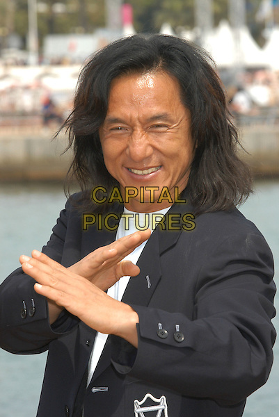 "JACKIE CHAN.Photocall for ""Around the world in 80 Days"",.Cannes Film Festival, France,.18th May 2004..half length hands gesture funny.Ref: PL.www.capitalpictures.com.sales@capitalpictures.com.©Capital Pictures."