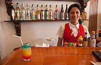 Cuba, Trinidad.  Woman Bartender Proud of her Trinidad Colonial, an Alcoholic Mixed Drink.