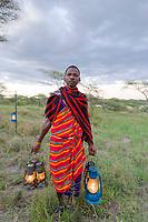 Masai tribesman with lanterns, Serengeti National Park, Tanzania, East Africa