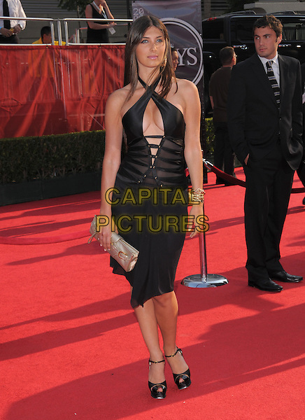 BRITTNY GASTINEAU.The 2008 ESPY Awards held at The Nokia Center in Los Angeles, California, USA..July 16th, 2008.full length britney black dress cut out away cleavage halterneck criss cross  silver clutch bag lace up .CAP/DVS.©Debbie VanStory/Capital Pictures.