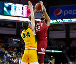 SIOUX FALLS, SD - MARCH 7: JaVonni Bickham #42 of the Denver Pioneers goes up for a jump shot against Tyler Witz #44 of the North Dakota State Bison at the 2020 Summit League Basketball Championship in Sioux Falls, SD. (Photo by Richard Carlson/Inertia)