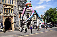 Giant inflatable octopus on The Guildhall as part of the Mayor's celebration weekend, Norwich UK July 2017