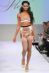 Model walks runway in lingerie from Fleur of England, during the Lingerie Fashion Night - Romancing The Runway show, by CurvExpo and Lycra on February 23, 2015.
