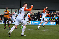 Cameron McGeehan of Luton Town (2nd right) celebrates scoring his team's first goal against Barnet with Scott Cuthbert of Luton Town (right) and Jack Marriott of Luton Town (3rd right) during the Sky Bet League 2 match between Barnet and Luton Town at The Hive, London, England on 28 March 2016. Photo by David Horn.