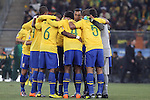 20 JUN 2010:  Brazil huddles prior to the opening match kick off.  The Brazil National Team led the C'ote d'Ivoire National Team 1-0 at the end of the first half at Soccer City Stadium in Johannesburg, South Africa in a 2010 FIFA World Cup Group G match.