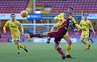 Bradford City's Paul Caddis clears away from Fleetwood Town's Ched Evans<br /> <br /> Photographer David Shipman/CameraSport<br /> <br /> The EFL Sky Bet League One - Bradford City v Fleetwood Town - Saturday 9th February 2019 - Valley Parade - Bradford<br /> <br /> World Copyright &copy; 2019 CameraSport. All rights reserved. 43 Linden Ave. Countesthorpe. Leicester. England. LE8 5PG - Tel: +44 (0) 116 277 4147 - admin@camerasport.com - www.camerasport.com