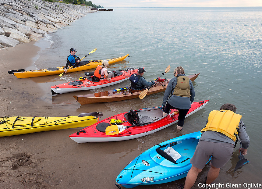 Under a pastel sky and water as smooth as glass, eight kayakers paddled out onto Lake Huron at Brights Grove for a Water and Wings night. From left are; Joe Burley, Sheila Lemieux, Peter Braun, Bev Lawrence and Riky Muir.