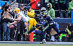 Green Bay Packers wide receiver Jordy Nelson (87) mishandles a catch while being guarded by Seattle Seahawks cornerback Jeremy Lane (20)  during the NFC Championship game at CenturyLink Field in Seattle, Washington on January 18, 2015.  The Seattle Seahawks beat the Green Bay Packers in overtime 28-22 for the NFC Championship Seattle.  ©2015. Photo by Jim Bryant, All Rights Reserved.