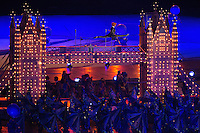 12 AUG 2012 - LONDON, GBR - A tightrope artist performs above a model of Tower Bridge during the Street Party section of the London 2012 Olympic Games Closing Ceremony in the Olympic Stadium in the Olympic Park, Stratford, London, Great Britain .(PHOTO (C) 2012 NIGEL FARROW)