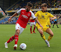 Fleetwood Town's Ched Evans tries to get round Oxford United's Luke Garbutt<br /> <br /> Photographer David Shipman/CameraSport<br /> <br /> The EFL Sky Bet League One - Oxford United v Fleetwood Town - Saturday August 11th 2018 - Kassam Stadium - Oxford<br /> <br /> World Copyright &copy; 2018 CameraSport. All rights reserved. 43 Linden Ave. Countesthorpe. Leicester. England. LE8 5PG - Tel: +44 (0) 116 277 4147 - admin@camerasport.com - www.camerasport.com