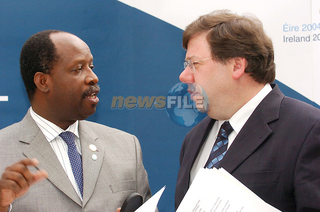 Dublin Ireland. EU - African Union Troika, Conference on Conflict Prevention. (L) Mr. Leonardo Simao Foreign Minister of Mozambique speaking to  Brian Cowen Irish Foreign Minister, after the EU- African Union Troika in Farmleigh House, Dublin Ireland. 1th April 2004.Photo AFP/NEWSFILE/FRAN CAFFREY..(Photo credit should read FRAN CAFFREY/NEWSFILE/AFP).....This Picture has been sent you under the condtions enclosed by:.Newsfile Ltd..the Studio,.Millmount Abbey,.Drogheda,.Co Meath..Ireland..Tel: +353(0)41-9871240.Fax: +353(0)41-9871260.GSM: +353(0)86-2500958.email: pictures@newsfile.ie.www.newsfile.ie.FTP: 193.120.102.198..This picture is from Fran Caffrey@newsfile.ie