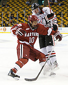 Eric Kroshus (Harvard - 10), Garrett Vermeersch (Northeastern - 9) - The Harvard University Crimson defeated the Northeastern University Huskies 3-2 in the 2012 Beanpot consolation game on Monday, February 13, 2012, at TD Garden in Boston, Massachusetts.