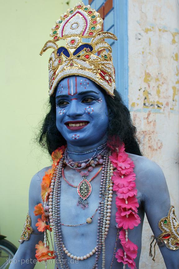 actor performing as krishna in street procession t  in Pushkar, Rajastan, India