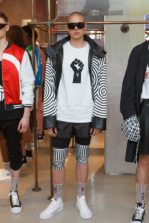"""Models pose in outfits from the Ricardo Seco Spring Summer 2019 """"Vision"""" collection fashion presentation at Flying Solo, in New York City, on July 9, 2018; during New York Fashion Week: Men's Spring Summer 2019."""