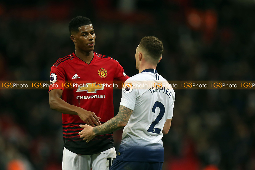 Kieran Trippier of Tottenham Hotspur and Paul Pogba of Manchester United after Tottenham Hotspur vs Manchester United, Premier League Football at Wembley Stadium on 13th January 2019