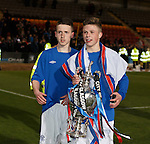 Adam Wilson holds onto the cup with Ben Reilly behind