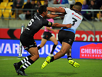 Te Maire Martin tries to stop Taane Milne during the 2017 Rugby League World Cup quarterfinal match between New Zealand Kiwis and Fiji at Wellington Regional Stadium in Wellington, New Zealand on Saturday, 18 November 2017. Photo: Dave Lintott / lintottphoto.co.nz