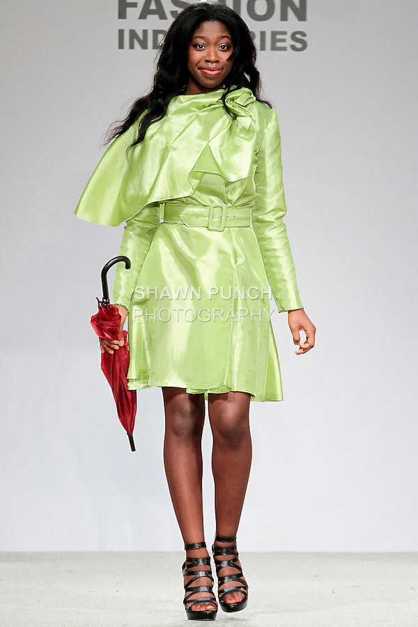 Model walks runway in an outfit by a graduating student during the High School of Fashion Industries 2013 fashion show, honoring Nicole Fischelis, May 14, 2013.